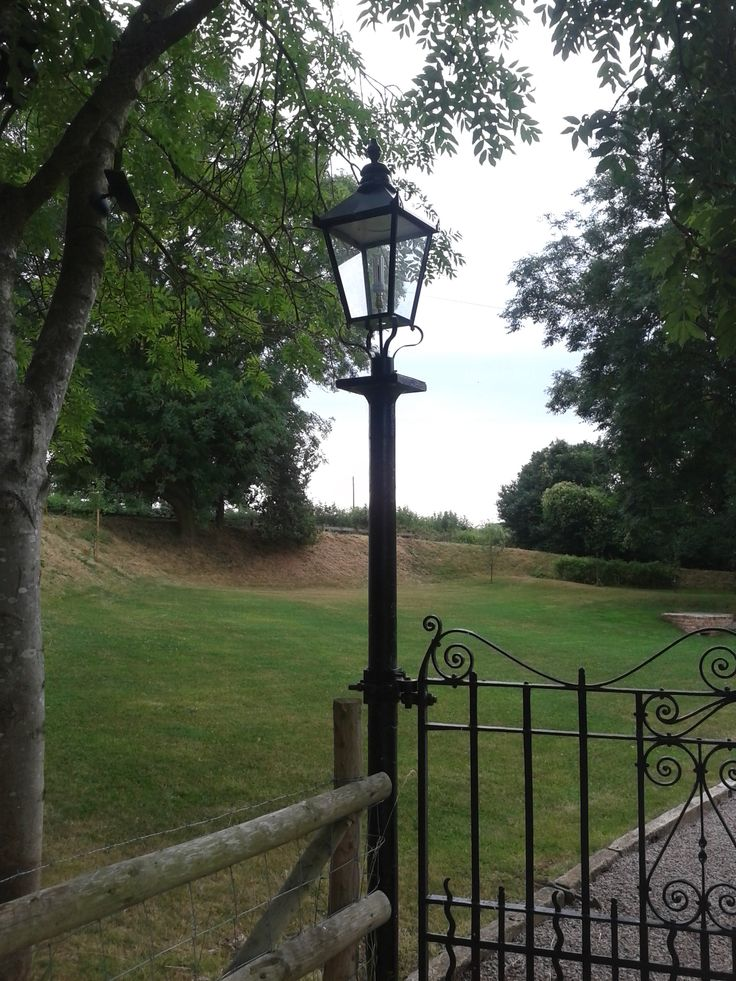 Large Black Lantern and Cast Iron Lamp Post