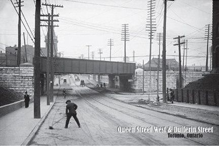 CCT0132 - Looking east along Queen Street West under the Queen Subway (railway underpass) at Dufferin Street. The Gladstone Hotel, built in 1889, can be seen in the background. Toronto, Ontario April 22, 1915.