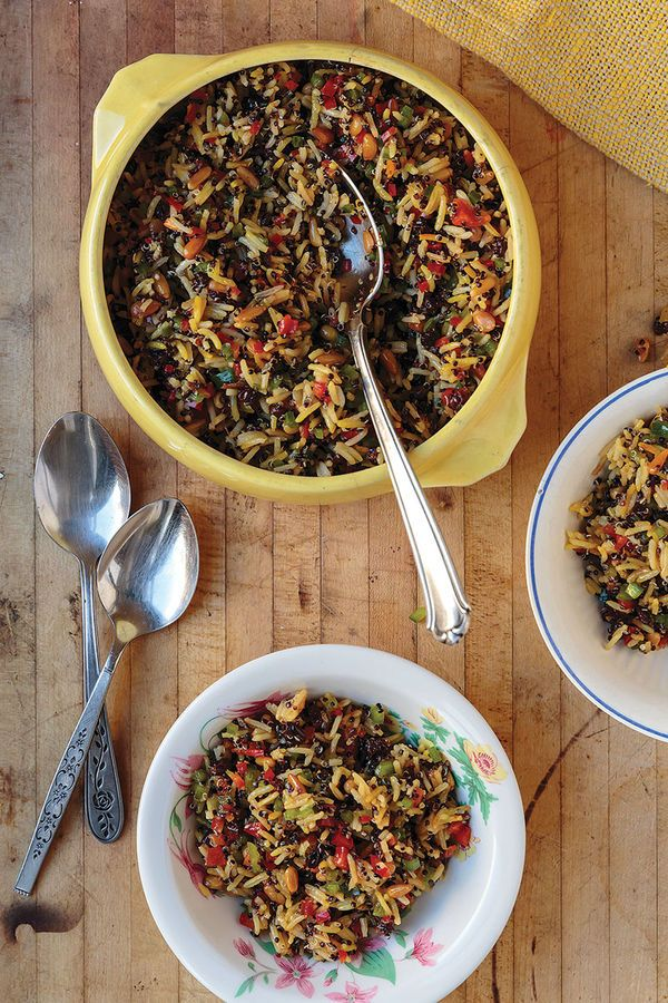 This 19th-century American recipe for rice pilaf from the Denver, Colorado, restaurant The Fort draws sweetness from dried fruit, earthiness from black quinoa and pine nuts, and crunch and color from bell pepper.