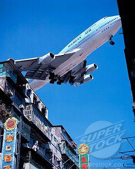 747 landing at Kai Tak Airport.
