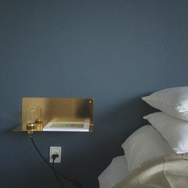 Some morning light cast on a bedside view from earlier this morning. The paint color is St. Paul's Blue, a collaboration between Frama and Jotun. Also featuring the brass 90° wall light by Frama Studio. @jotunlisbeth #stpaulsblue #framacph #framastudio