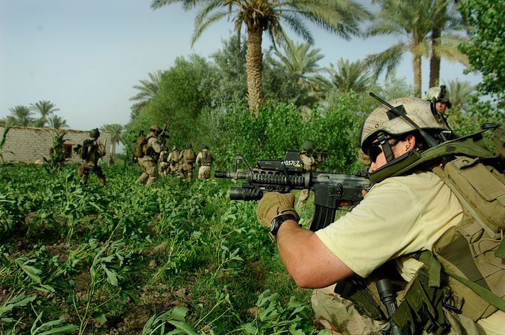 Special Forces soldiers on a join operation with Iraqi Commandos, Baghdad, 2007. Part of US strategy against the insurgency has included having Special Forces establish, train and operate alongside Iraqi Special Operations Forces.