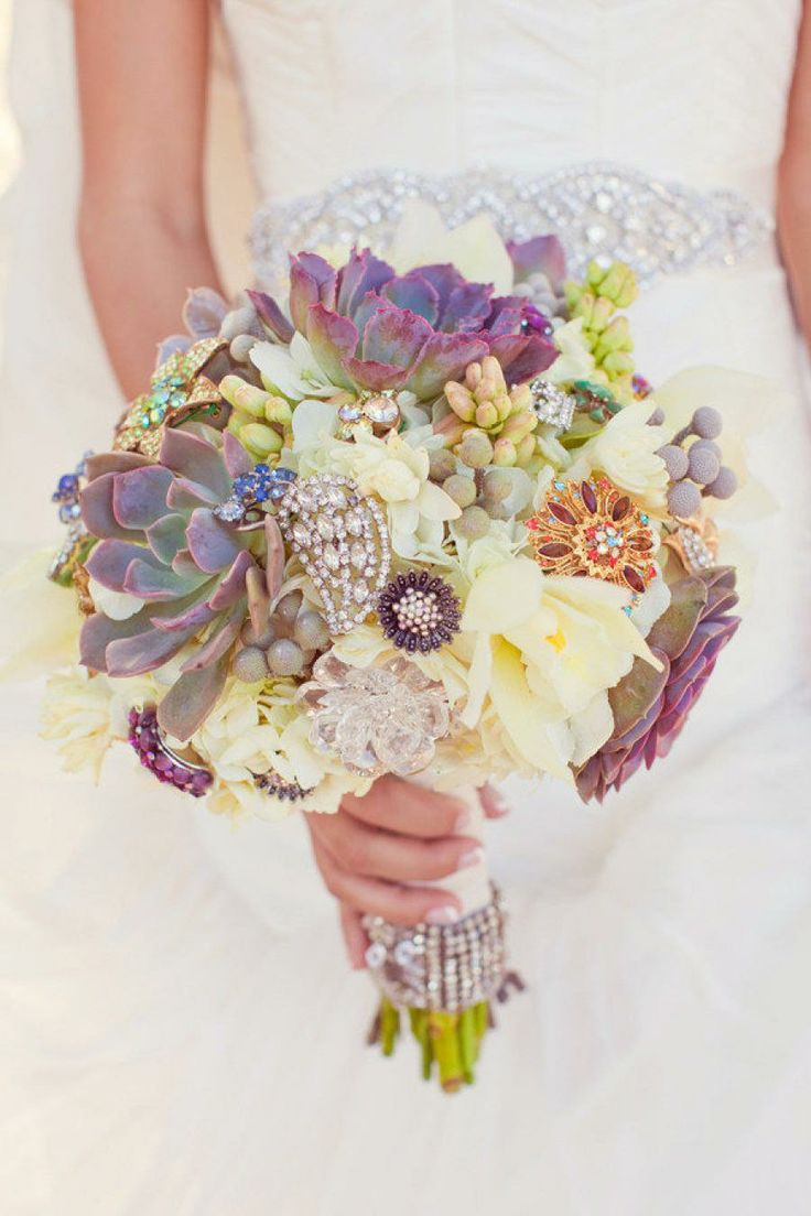 Gorgeous bouquet of mixed succulents, flowers and sparkly brooches.