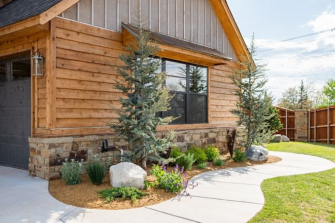 The Home Exterior Features Gray Stained Board And Batten Cedar Siding And Reclaimed Barnwood That S How Log Homes Exterior Wood Siding Exterior House Exterior
