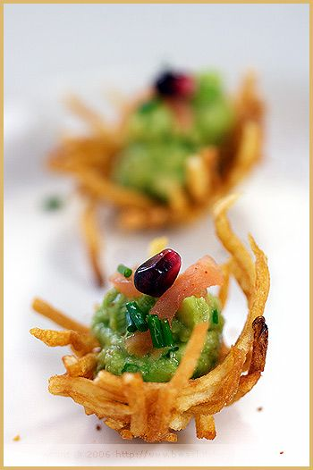 Potato Nests with Avocado and Smoked Salmon topped with pomegranate and chives