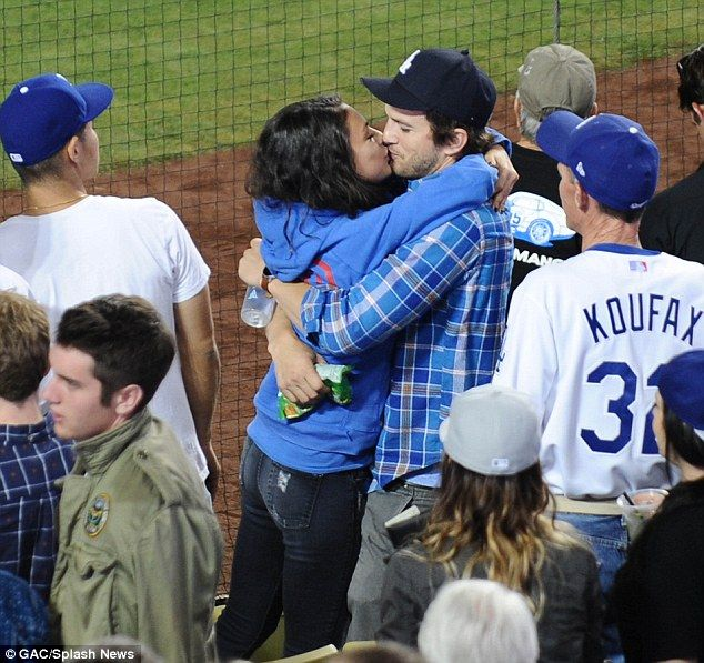 Mila Kunis and Ashton Kutcher kiss passionately at Dodgers game #dailymail