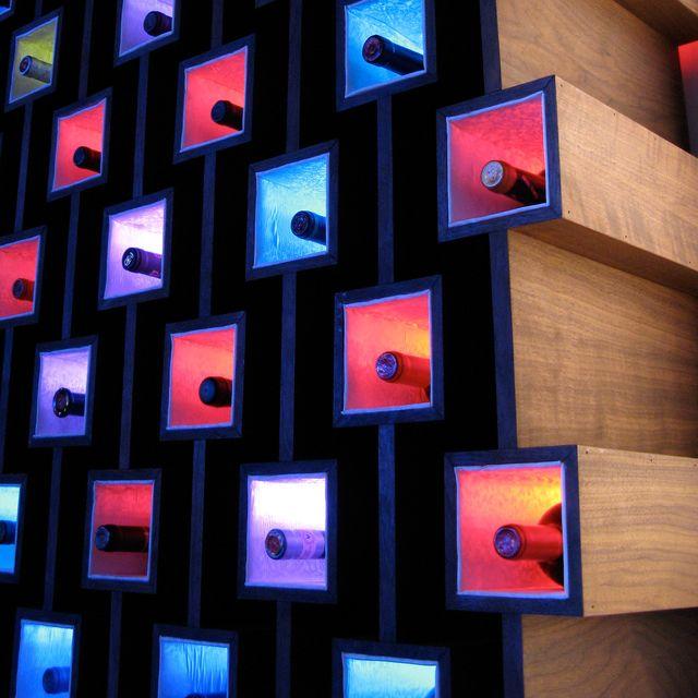 Beautiful wine storage design...I love the colorful lighting!!