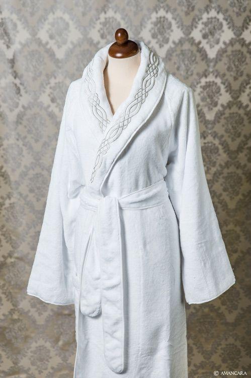 White terry cloth bathrobe with metallic silver embroidery.
