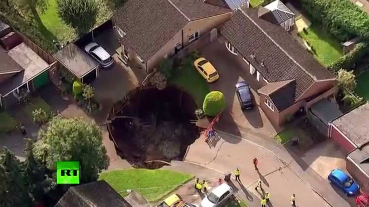 Giant sinkhole swallows street in London suburban