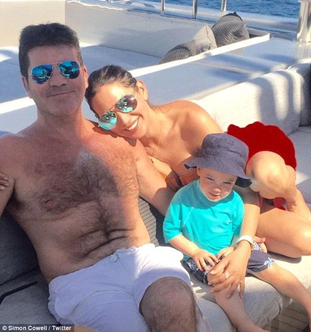 Simon Cowell posts precious holiday snap with sun-kissed Lauren Silverman and mini-me son Eric