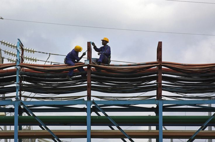 Workers maintain a thermal power station