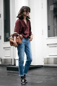 We don't even know where to start with this killer look, but we will try our best. Blogger Diana is the epitome of casual chic in her burgundy Acne silk shirt, frayed hem jeans and sexy black heeled sandals. The wavy bob and camel Loewe bag are the icing on the cake.