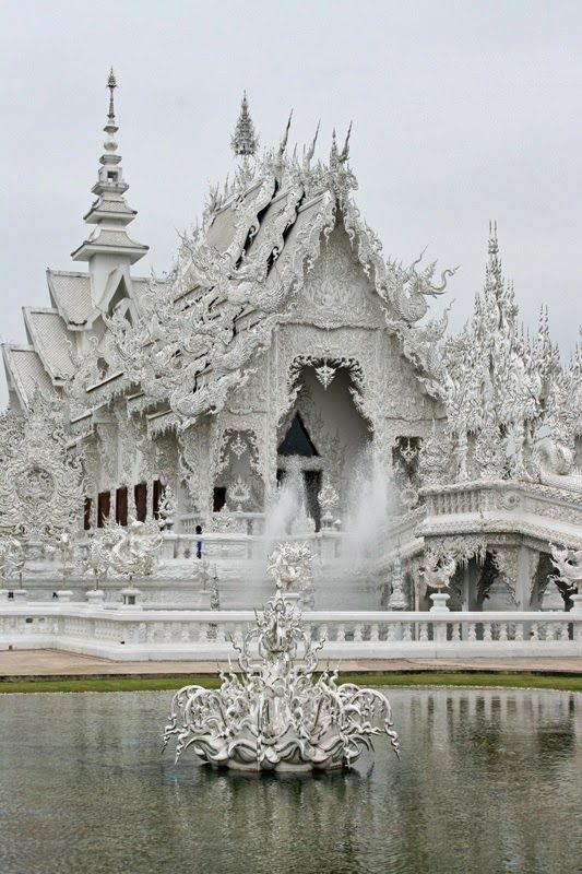 Wat Rong Khun more well-known among foreigners as the White Temple, is a contemporary unconventional Buddhist temple in Chiang Rai, Thailand. It was designed by Chalermchai Kositpipat in 1997. 15 Strange Buildings you'd love to see | Incredible Pictures