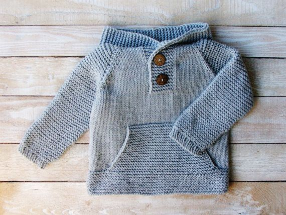 This sweater will fit baby and toddler boys up to 3 years old.  Hand knitted from 100% easy care acrylic yarn, this pullover features a roomy,