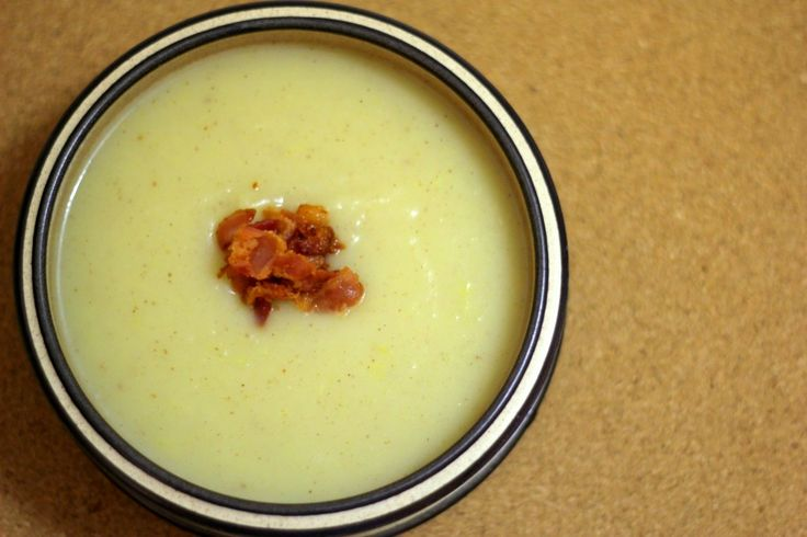 Potato and Leek Soup Topped with Crispy Bacon - sprinkles and sauce