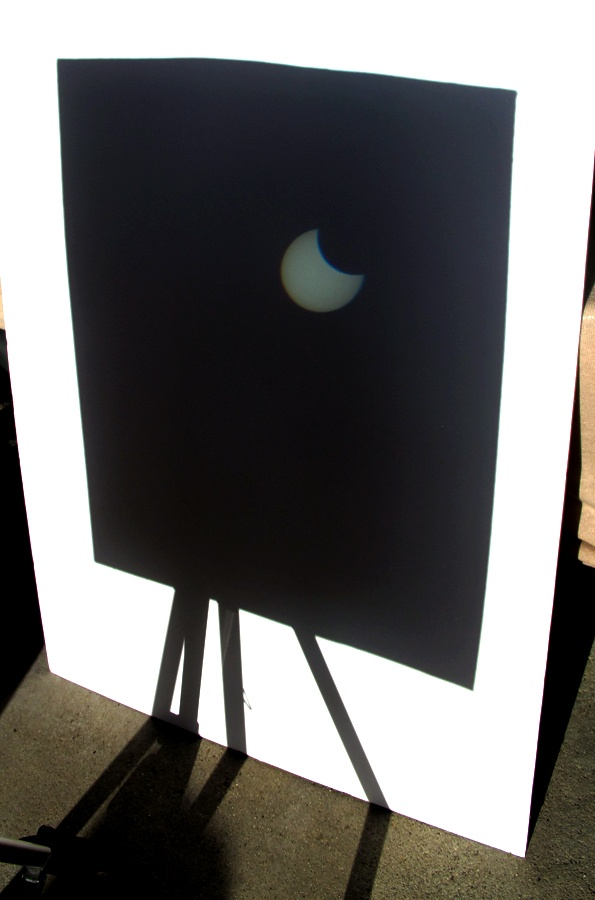 Beginning of our solar eclipse today, May 20, 2012---used binoculars, cardboard, white board a tripod & duct tape....photo by Mark W. Patterson