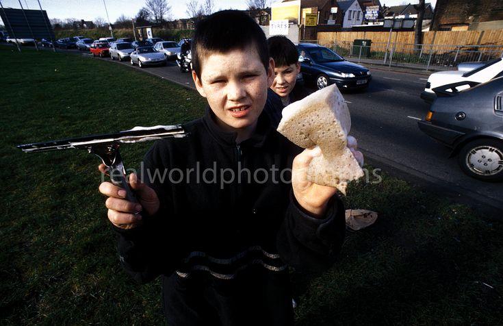 North Circular window washers. North London, England. Gary Moore photo. #streetphotography #photojournalism #portrait #northlondon #boys #work #london #realworldphotographs