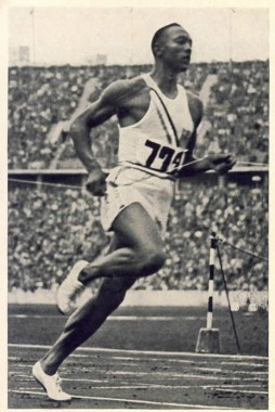 Berlin 1936 Olympics - Jesse Owens American Athlete takes home gold in track & field, thus making a mockery of aryan superiority in Hitler's stadium.  Yay Jesse!!!!