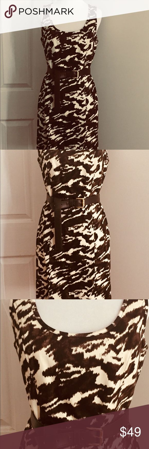 """MICHAEL Michael Kors Dress MiCHAEL Michael Kors stunning animal print dress. Inject a hint of the exotic, into your going out wardrobe. Full length gold metal zipper down the back. It has a cut out top, making it look sexy yet classy. Really nice, form fitting flattering knee length lightly worn dress. Very good condition!! Cream& brown 36""""inches from shoulder to hem. SMOKE FREE AND PET FREE HOME. MICHAEL Michael Kors Dresses Midi"""