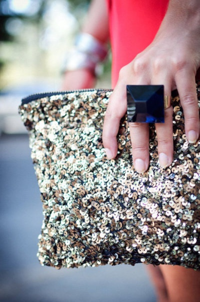 glitter clutch and statement ring