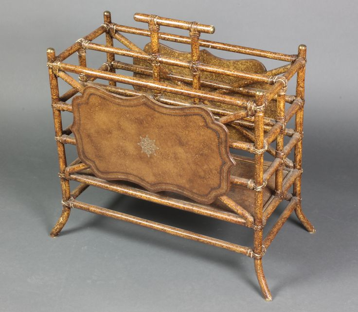 """Lot 991, A bamboo twin division Canterbury 21""""h x 22""""w x 11""""d, est £50-100"""