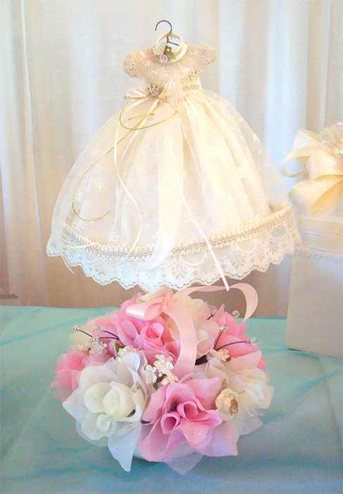 Such a cute centerpiece for a baby girl's christening