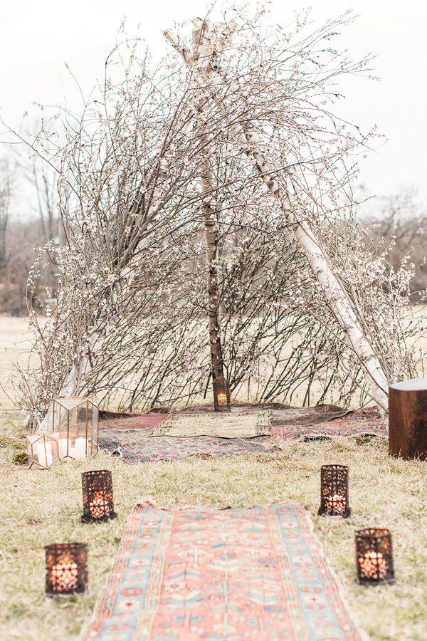 bohemian tent altar - photo by Lauren Fair Photography http://ruffledblog.com/bohemian-wildflower-wedding-inspiration