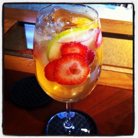 My Signature Quick White Sangria Recipe Yumm    Bottle of Reisling  Bottle of Gingerale  Small bottle of brandy  Orange, Apple, Blue berries, rasberries & strawberries    By the Glass:   Half wine - Half Gingerale  1 Cap full of Brandy   1 slice of Orange squezzed into glass before added  then add additional fruit