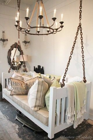 It's a crib, turned into a swing. Indoors! Who needs a couch? | The Cottage Market: 25 Upcycled Furniture Ideas