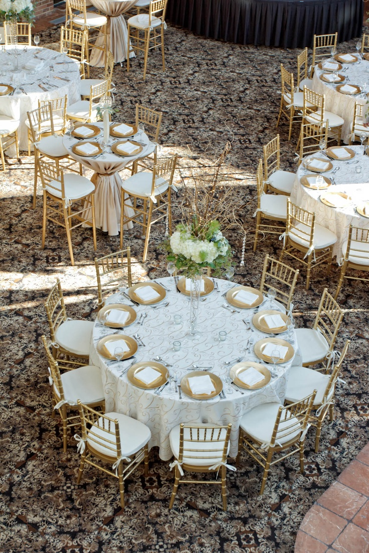 Cream and Gold Weding. I like the centerpieces, but would pefer if they were shorter with the flowers closer to the table.  Perhaps surrounded with mason jars, candles, etc.