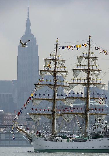 NYC 2012 Fleet Week Parade, the tall ship from Colombia, Gloria, sails past the Empire State Building