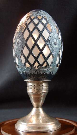 "NOT AN IMPERIAL EGG. THE BASE LOOKS LIKE IT WAS FORMERLY A CANDLE HOLDER. Perhaps made several weeks ago? PROVENANCE please. Former incorrect caption: ""Faberge Imperial Egg"""