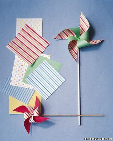 Colorful pinwheels, made out of coordinating sheets of origami or lightweight paper, stand tall against a blue summer sky, poised to whirl at the slightest suggestion of wind.