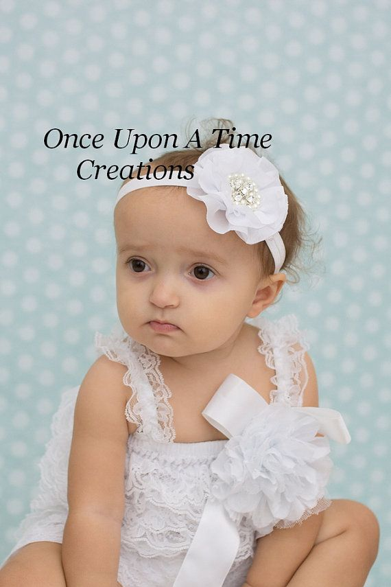White Jewel Headband    Gorgeous white chiffon flower topped with pearls and rhinestones on a matching soft elastic headband. This can also be