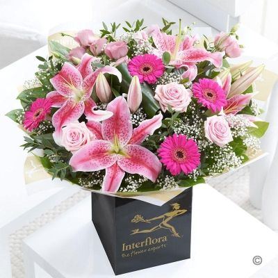 Fishlocks Pink Radiance Hand-Tied  As one of our most popular gifts, this beautiful selection includes classic pink roses and fragrant Oriental lilies with pretty germinis and a sprinkling of gypsophila. This chic and contemporary hand-tied bouquet is rich with texture and detail, and the lilies add a beautiful sweet scent.