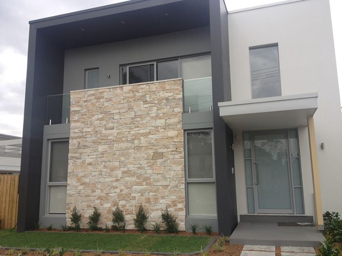 Image result for sandstone stacked stone on grey house