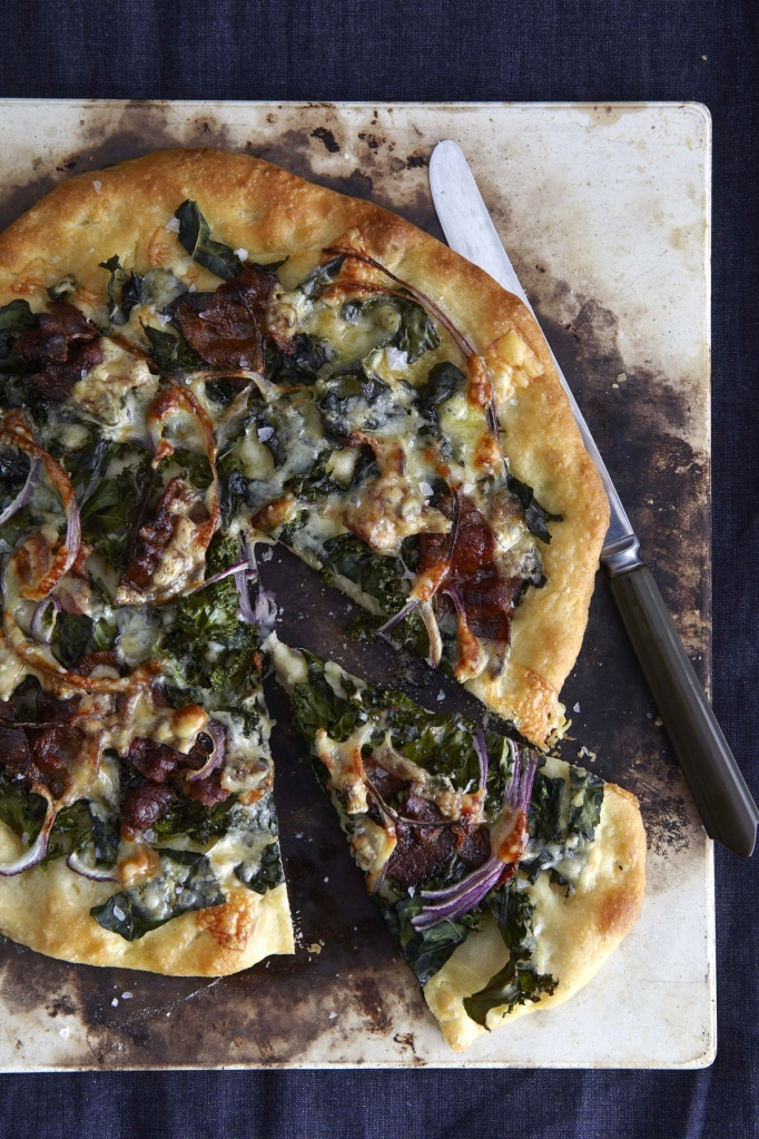 homemade pizza with kale, caramelized red onion, bacon  gorgonzola