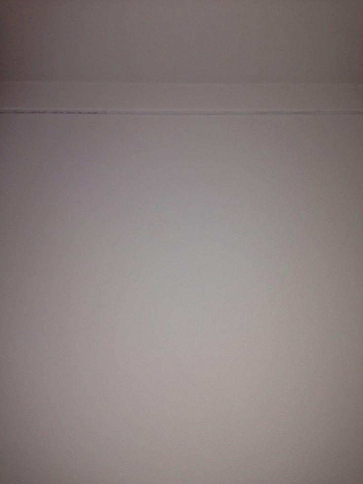 Ophangsysteem voor schilderijen in muur stucen