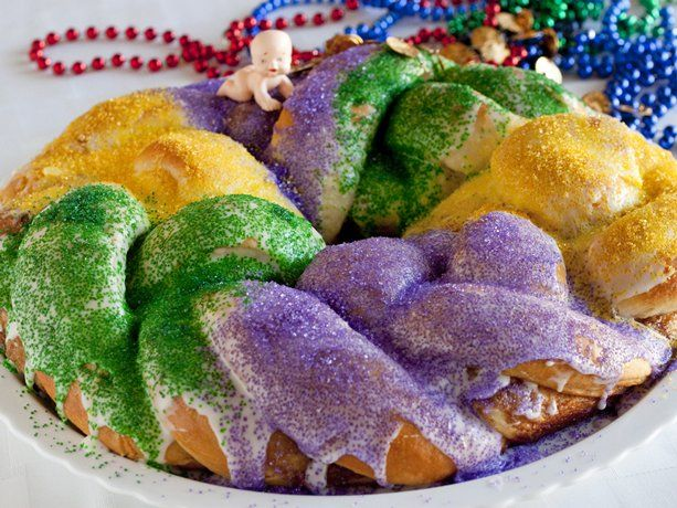 the baby doll is hidden in the cake...if you find the baby in your slice of King's Cake...you buy the next cake...love it...and beads are ALWAYS included in the cake packaging... tradition !