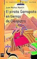 """""""el pirata garrapata en tierras de cleopatra"""" dejuan muñoz martin Huyendo de los tragaldabas y otras tribus del África, el pirata Garrapata y su tripulación llegan hasta el río Nilo y allí descubren que los grandes sacerdotes del faraón, convencidos de que la hermosa Floripondia es la reencarnación de la diosa Isis, la han secuestrado. Garrapata tiene que pasar por mil avatares antes de conseguir rescatar a la dama.  DE 9 A 11 AÑOS. Signatura: V pir"""