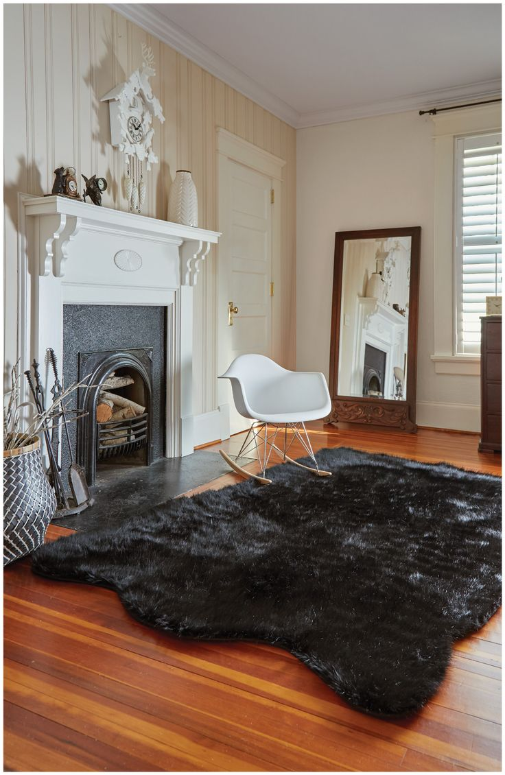 This black shag rug adds a touch of glam to this vintage living space.