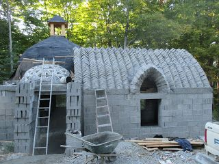 House built with topologically interlocking bricks designed by Peter Roberts of  Spherical Block LLC