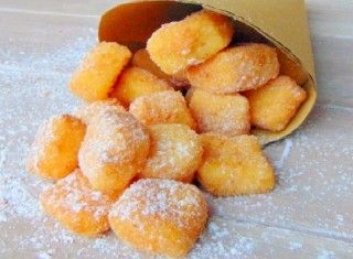 Battered and fried thick cream or custard, dusted with icing sugar