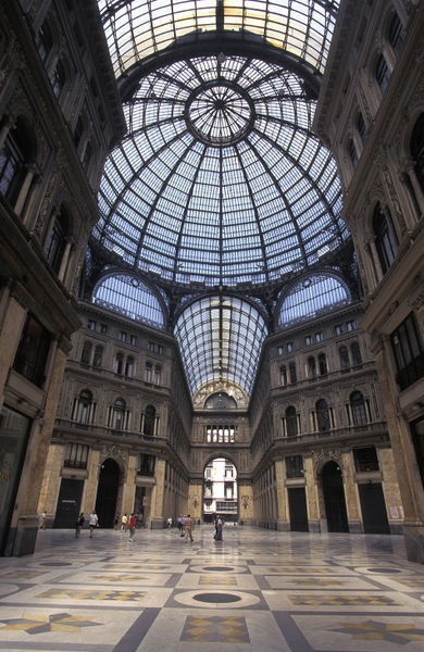 King Umberto I shopping arcade across from the palace in Naples, Italy Right outside the doors directly across from the museum, is amazing pizza marinara with garlic and olives, sooo good.