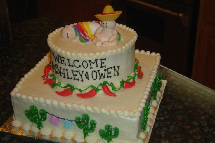 """Mexican themed baby shower - This baby shower cake was designed for a couple expecting twins, and the theme of the shower was """"Mexican fiesta""""!  All buttercream w/ fondant accents and babies.   Quite unusual, I know!"""