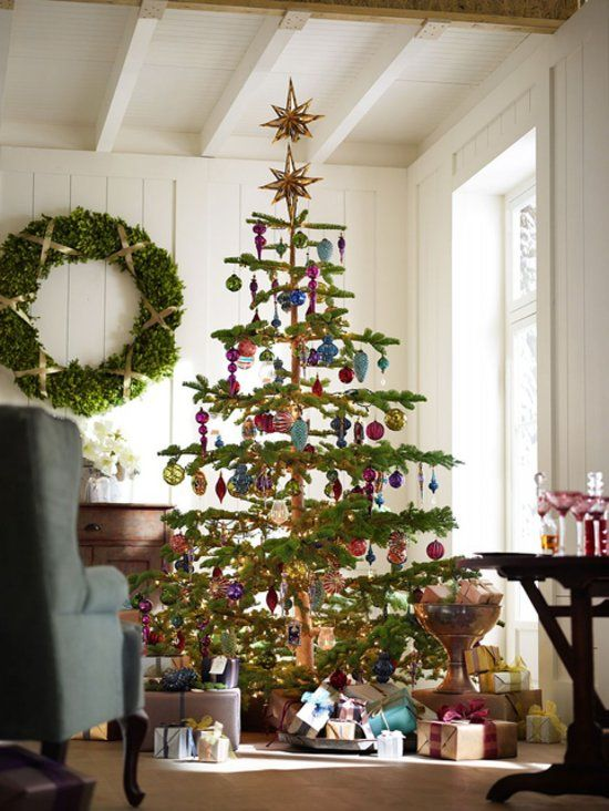 I love this kind of tree with loads of space between for ornaments and candles