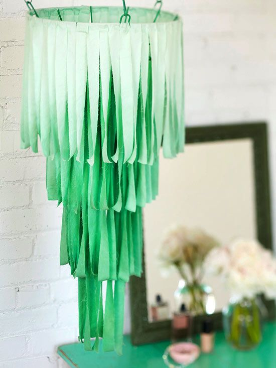 Go with the Flow   Go with the Flow    Re-create this modern-style chandelier in no time. Spray-paint a wire hanging basket (used for plants), dip-dye fabric strips, and drape the strips over the wire framework in a cascading pattern.