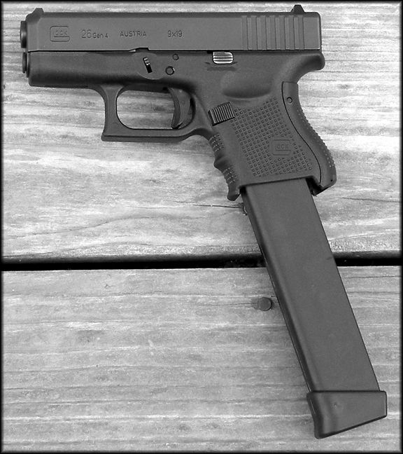 Glock 26 gen. 4 with an extended mag