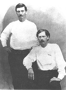 Bat Masterson (left) and Wyatt Earp in Dodge City, 1876. The scroll on Earp's chest is a cloth pin-on badge