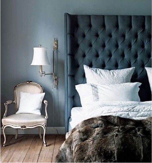 Deep blue tufted #headboard with white sheets and a #fur throw.  Perfect #bedroom